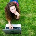 Girl doing her homework outdoors — Stock Photo #27868103