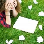 Girl doing her homework outdoors — Stock Photo #27868417