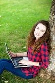 Girl doing her homework outdoors — Stock Photo