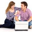 Teenage couple using laptop — Stock Photo #27879275