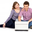 Stock Photo: Teenage couple using laptop