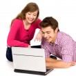 Teenage couple using laptop — Stock Photo