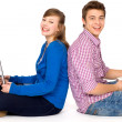 Happy students sitting — Stock Photo