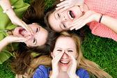 Three young women shouting — Stock Photo