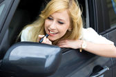 Woman Applying Lipstick in Car Mirror — Stock Photo