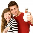 Couple taking photo of themselves — Stock Photo #27881269