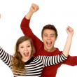 Couple with arms raised — Stock Photo