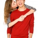 Woman kissing man — Stock Photo #27881537
