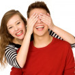 Woman covering boyfriends eyes — Stockfoto