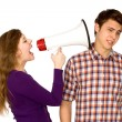 Woman shouting at man through megaphone — ストック写真
