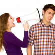 Woman shouting at man through megaphone — Stock Photo