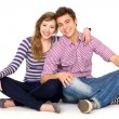 Young couple sitting — Stock Photo #27882383