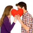 Couple holding red heart — Stockfoto
