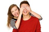 Woman covering boyfriends eyes — Stock Photo