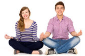 Couple sitting in lotus position — Stock Photo