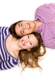 Young couple lying head to head — Stock Photo
