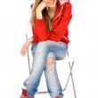 Teenage girl sitting — Stock Photo