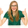 Girl showing thumbs up — Stock Photo #27893639