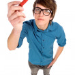 Young man holding pen — Stock Photo