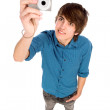 Young man taking pictures — Stock Photo