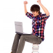 Student cheering with laptop — Stock Photo #27948929