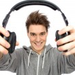 Young man wearing headphones — Stock Photo #27949587