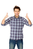 Casual young guy showing thumbs up — Stock Photo