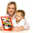 Mother and Son with Abacus — Stock Photo