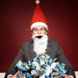 Santa with crumpled paper — Stock Photo