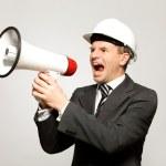 Workman ropade genom MegaFon — Stockfoto