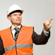 Construction worker pointing — Stock Photo #27997401