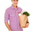 Young man with bag of groceries — Stock Photo
