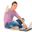 Man with laptop showing thumbs up — Stock Photo