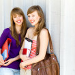 Young women carrying books — Stock Photo