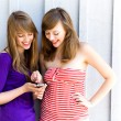 Stock Photo: Girls with mobile phone