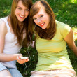 Young women listening to MP3 player — Stok fotoğraf