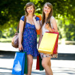 Friends with shopping bags — Stockfoto