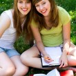 Girls studying outdoors — Stok fotoğraf