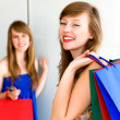 Stock Photo: Friends with shopping bags