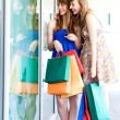 Friends with shopping bags — Stock Photo #28046243