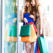 Friends with shopping bags — Stock Photo