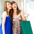 Friends with shopping bags — Stok fotoğraf