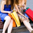 Friends with shopping bags — 图库照片