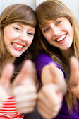 Girls with thumbs up — Stock Photo