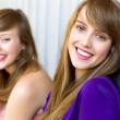 Young women smiling — Stock Photo #28050551