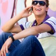 Young man using mobile phone — Stock Photo