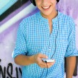 Young man with mp3 player — Stock Photo