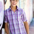 Young guy leaning on graffiti wall — Stock Photo