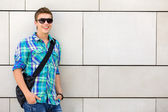 Student standing against wall — Stock Photo