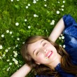 Stock Photo: Young woman lying on the grass